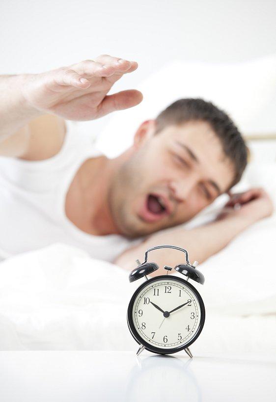 Sleeping man with alarm
