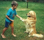Vladimir is playing with a dog, 2001